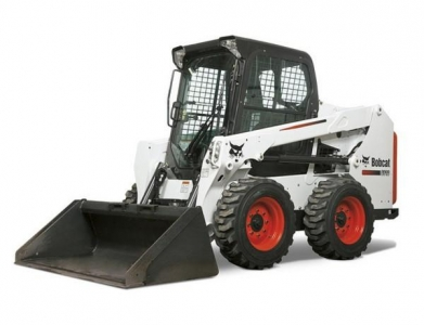 Bobcat – S450 W/Forks and Bucket.  (Trailer Additional)