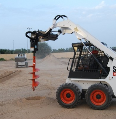 Bobcat – S450 W/Auger and Bucket.  (Trailer Additional)
