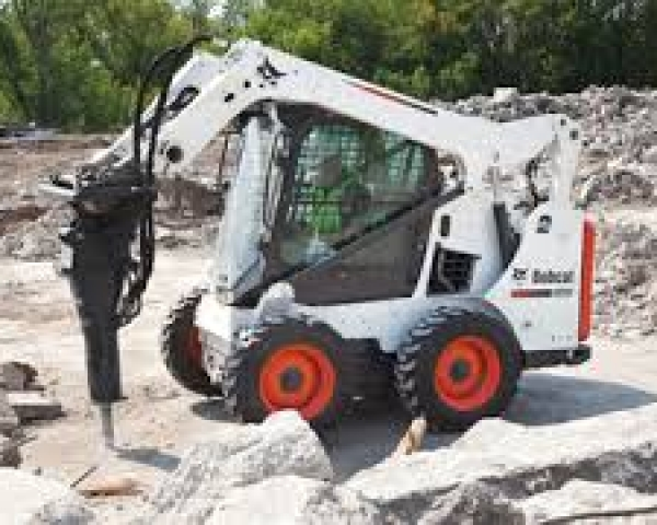 Bobcat – S450 W/Jack Hammer and Bucket.  (Trailer Additional)
