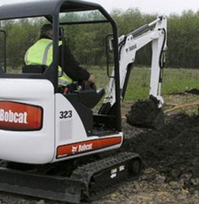 Bobcat 323 – Mini Excavator 7′.  (Trailer Additional)